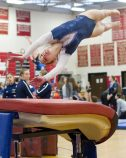 Oxford's Anna Gramlich competes in the vault exercise during the Pomperaug Invitational gymnastics meet held Saturday at Pomperaug High School. Jim Shannon Republican American
