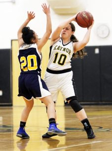 #10 Danielle Salvati of Kaynor Tech. looks to pass inside as #20 Amaryllies Rivera of Kennedy defends during basketball action in Waterbury Monday. Steven Valenti Republican-American