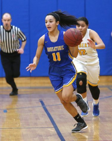 WINSTED CT. 09 January 2019-010819ER03-Housatonic Regional High School's Sierra O'Niel looks for an open teammate ahead of Gilbert High School's Marcela Moreira during the girls varsity basketball game on Tuesday night. Emily J. Reynolds. Republican-American