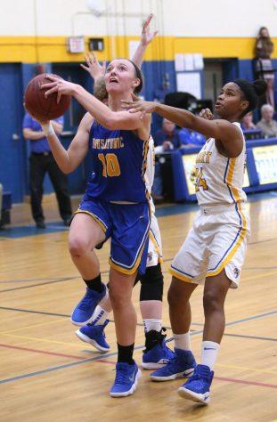 Housatonic Regional High School's Caroline Hurlburt goes up for a shot over Gilbert High School's Dileysi Sarmiento during the girls varsity basketball game on Tuesday night. Emily J. Reynolds. Republican-American