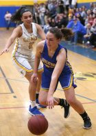 Housatonic Regional High School's Madelynn Olownia dribbles to the basket in front of Gilbert High School's Angelina Delacruz during the girls varsity basketball game on Tuesday night. Emily J. Reynolds. Republican-American