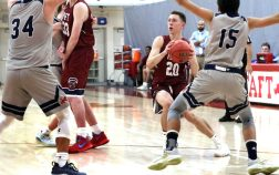 #20 Connor Printz of Taft looks to pass inside against Kent during basketball action in Watertown Wednesday. Steven Valenti Republican-American
