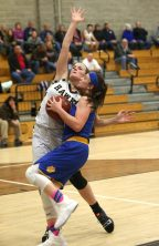 Seymour High School's Morgan Teodosio goes up for a shot over Woodland High School's #10 during the girls varsity basketball game at Woodland Regional High School on Thursday night. Emily J. Reynolds. Republican-American