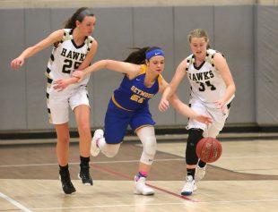 Seymour High School's Morgan Teodosio battles Woodland High School's Ava DeLucia, left, and Jillian Barbarito for the ball during the girls varsity basketball game at Woodland Regional High School on Thursday night. Emily J. Reynolds. Republican-American