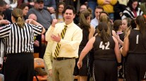 Thomaston head coach Bob McMahon was holing for a foul call as a time out is called between their game with Terryville Friday at Terryville High School. Jim Shannon Republican American