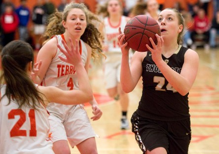 Thomaston's Emma Sanson (24) lays up a shot in front of Terryville's Amy Roqi (21) during their Berkshire League match up Friday at Terryville High School. Jim Shannon Republican American