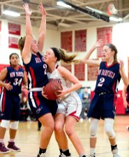 Pomperaug's Cara McGettigan (4) is called for a charge while driving to the basket against New Fairfield's Kerrigan Quinn (24) during their SWC game against New Fairfield Tuesday at Pomperaug High School. Jim Shannon Republican American