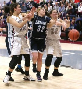 Ansonia High School's Lilly Romanowski battles Naugatuck High School's Sarah Macary, left, and Hailey Dehlebam for the ball during the girls varsity basketball game in Waterbury on Wednesday night. Emily J. Reynolds. Republican-American
