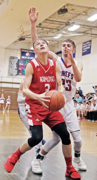 Wamogo's Sean Coffey (#3) looks to put up a shot as Nonnewaug's James Gengenbach (#23) defends during Berkshire League action Thursday night at Nonnewaug High School. Wamogo easily defeated Nonnewaug. Michael Kabelka / Republican-American