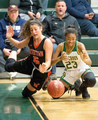 WATERBURY, CT-011819JS06- Watertown's Jordyn Forte (5) and Holy Cross' Cayla Howard (23) scramble for a loose ball along the baseline during their game Friday at Holy Cross High School. Jim Shannon Republican American