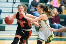 Watertown's Jordyn Forte (5) drives the baseline against Holy Cross' Hannah Brown (11) during their game Friday at Holy Cross High School. Jim Shannon Republican American