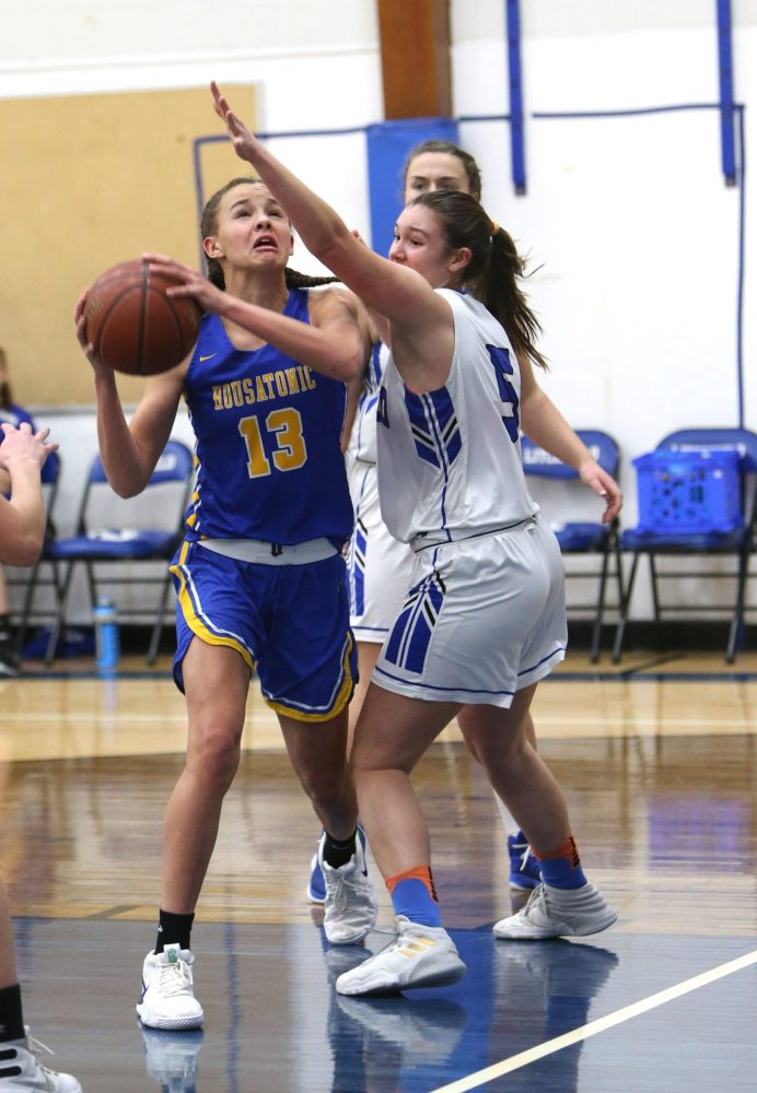 Housatonic High School's Sydney Segalla goes up for a shot over Litchfield High School's Allie Davenport during the girls varsity basketball game in Litchfield on Tuesday, Jan. 22, 2019. Emily J. Reynolds. Republican-American