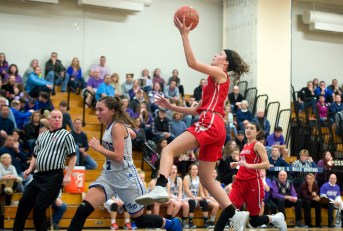 Northwestern's Emma Propfe (13) lays up a shot over Lewis Mills' Brianna Pelchar (5) during their NVL match up Friday at Lewis Mills. Jim Shannon Republican American