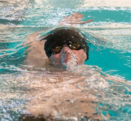Woodland's Greg Aldrich emerges from the water while competing in the 200 individual medley during their meet with Holy Cross Friday at the John Reardon Pool at Kennedy High School in Waterbury. Jim Shannon Republican American