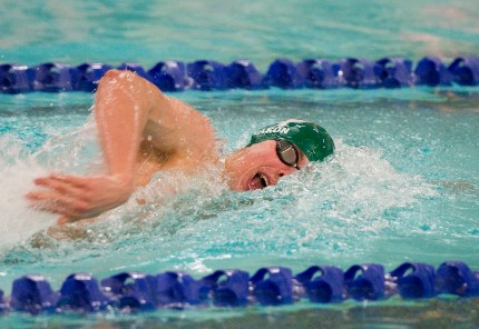 Holy Cross' Sam Mason competes in the 100 freestyle during their meet with Woodland Friday at the John Reardon Pool at Kennedy High School in Waterbury. Jim Shannon Republican American
