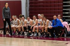 Naugatuck players and coaches look on from the sidelines very late, during a second round tournament game in the Girls Class L Basketball Championships between Bristol Eastern and Naugatuck at Naugatuck High School in Naugatuck on Thursday. Bill Shettle Republican-American