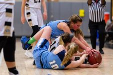 Oxford's Jessica Kondic #12 dives in on Woodland's Gabby Mastropietro #10 and Oxford's Molly Sastram #10 for control and posession of a loose ball very late in the game during a Girls NVL Basketball game between Oxford and Woodland at Woodland Regional High School in Beacon Falls on Saturday. Oxford came back after being down by 10 at half to beat Woodland 42-39. Bill Shettle Republican-American