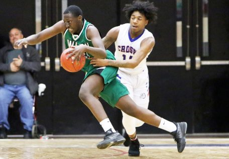#13 Shariff Bilewu of Wilby High drives past #12 Tyler Spears of Crosby High during NVL basketball action in Waterbury Monday. Steven Valenti Republican-American