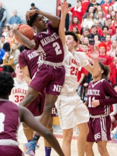 Naugatuck's Gwayne Fisher (2) tries to get a shot off in front of Wolcott's Elmin Redzepagic (23) during their NVL game Tuesday at Wolcott High School. Jim Shannon Republican American