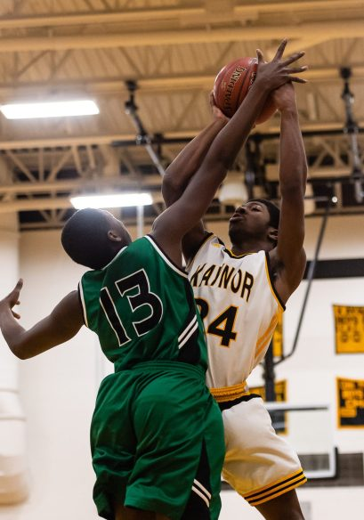 Kaynor Tech's Saijan McIntosh #24 shoots the ball against the defense of Wilby's Shariff Bilewu #13 during a non-league boys basketball game between Wilby and Kaynor Tech at Kaynor Tech High School in Waterbury on Wednesday. Kaynor Tech edged out Wilby at the end 68-58. Bill Shettle Republican-American
