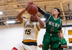 Wilby's Andres Urena #3 tries to block the shot of Kaynor Tech's Quinten Asiedu #15, as he drives to the basket during a non-league boys basketball game between Wilby and Kaynor Tech at Kaynor Tech High School in Waterbury on Wednesday. Kaynor Tech edged out Wilby at the end 68-58. Bill Shettle Republican-American