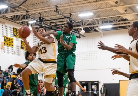 Kaynor Tech's Jared Gomez #13 drives to the basket against Wilby's Zoharius Shelton #21during a non-league boys basketball game between Wilby and Kaynor Tech at Kaynor Tech High School in Waterbury on Wednesday. Bill Shettle Republican-American