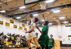 Kaynor Tech's Fernando Cerda #10 looks to go up and under the reverse way to the basket against Wilby's Zoharius Shelton #21 defending, during a non-league boys basketball game between Wilby and Kaynor Tech at Kaynor Tech High School in Waterbury on Wednesday. Kaynor Tech edged out Wilby at the end 68-58. Bill Shettle Republican-American