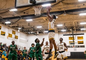Kaynor Tech's Nashua Lovett #22 throws down an alley-oop pass for a dunk during a non-league boys basketball game between Wilby and Kaynor Tech at Kaynor Tech High School in Waterbury on Wednesday. Kaynor Tech edged out Wilby at the end 68-58. Bill Shettle Republican-American