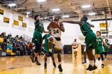 Kaynor Tech's Saijan McIntosh #24 drives down the lane towards the basket splitting in between Wilby defenders Andres Urena #3, left, and Shariff Bilewu #13 during a non-league boys basketball game between Wilby and Kaynor Tech at Kaynor Tech High School in Waterbury on Wednesday. Kaynor Tech edged out Wilby at the end 68-58. Bill Shettle Republican-American