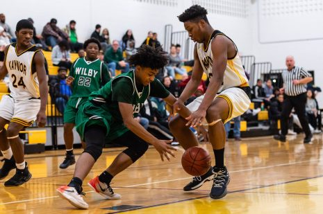 Kaynor Tech's Nashua Lovett #22 and Wilby's Jeremiah Tripp #11, battles for a loose ball during a non-league boys basketball game between Wilby and Kaynor Tech at Kaynor Tech High School in Waterbury on Wednesday. Kaynor Tech edged out Wilby at the end 68-58. Bill Shettle Republican-American