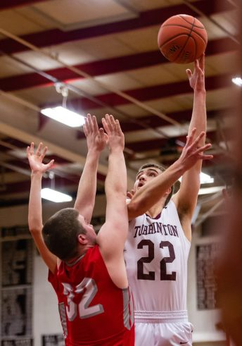 Torrington's Kevin Dixon #22 shoots a jump hook over the defense of Wolcott's Jack Dreary #32 during A Boys NVL Iron Division basketball game between Wolcott and Torrington at Torrington High School in Torrington on Thursday. Torrington beat Wolcott 57-47 pulling away late in a very close game. Bill Shettle Republican-American