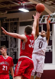 Torrington's Dontae Thomas stops and shoots a jumper in the lane against the lunging Jack Drewry #32 of Wolcott during A Boys NVL Iron Division basketball game between Wolcott and Torrington at Torrington High School in Torrington on Thursday. Torrington beat Wolcott 57-47 pulling away late in a very close game. Bill Shettle Republican-American