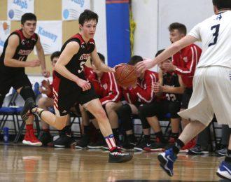 Wamogo High School's Reid Turtoro dribbles up the court during the boys varsity basketball game at Litchfield High School on Thursday night. Emily J. Reynolds. Republican-American