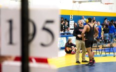 Northwestern coach Peter Folino talks with Jamikael Lytle as he prepares to compete in the 195 lb. semi-finals during the Berkshire-Valley Postseason Invitational held Saturday at the Gilbert School in Winsted. Jim Shannon Republican American