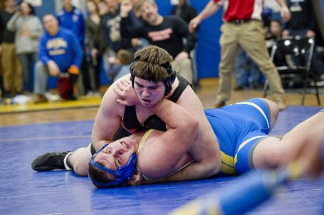 Northwestern's Nole Snieckus battles with Gilbert's Dylan Keith in the 258 lb. finals during the Berkshire-Valley Postseason Invitational held Saturday at the Gilbert School in Winsted. Jim Shannon Republican American
