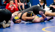 Northwestern's Jamikael Lytle looks to the referee for a signal as he pins Gilbert's Kevin Sullivan in the 195 lb. finals during the Berkshire-Valley Postseason Invitational held Saturday at the Gilbert School in Winsted. Jim Shannon Republican American