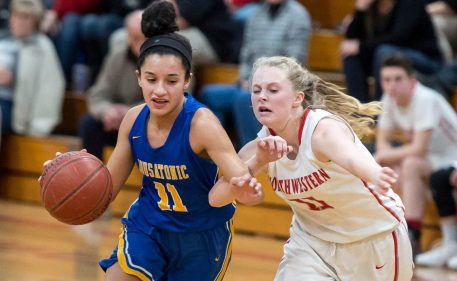 Housatonic's Sierra O'Niel (11) drives around Northwestern's Skylar Dimartino (11) during their Berkshire League game Monday at Northwestern. Jim Shannon Republican American