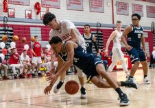 Wolcott's Elmin Redzepagic #23 and Ansonia's Glenn Hines #10 battle for a loose ball on the court, during a boys NVL basketball game between Ansonia and Wolcott at Wolcott High School in Wolcott on Wednesday. Bill Shettle Republican-American