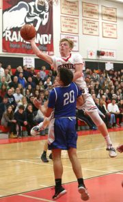 Cheshire High School's Colby Griffin goes up for a shot over Southington High School's Jake Napoli during the boys varsity basketball game at Cheshire High School on Friday, Feb. 15, 2019. Emily J. Reynolds. Republican-American