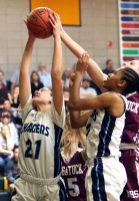 #21 Natasha Rivera of Ansonia pulls down the rebound against Naugatuck in overtime during the NVL girls basketball tournament in Waterbury Saturday. Steven Valenti Republican-American