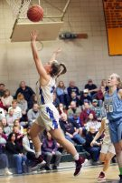 #5 Emma Cretella of St. Paul puts up a basket as #30 Paige Davis of Oxford defends during the NVL girlÕs basketball tournament in Waterbury Saturday. Steven Valenti Republican-American