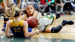 #14 Maeve Perrone of Holy Cross High and #10 Megan Condo of Seymour High battle for the loose ball during the NVL girlÕs basketball tournament in Waterbury Saturday. Steven Valenti Republican-American