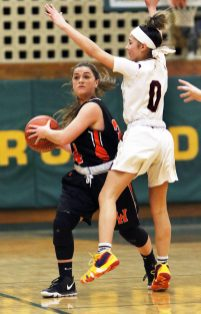 #34 Chloe DeFeo of Watertown High looks to pass as #0 Aamya Rivera of Sacred Heart High defends during the NVL girlÕs basketball tournament in Waterbury Saturday. Steven Valenti Republican-American