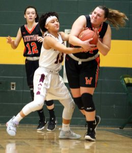 #24 Emily Deptula of Watertown High tries to keep the ball from #13 Mikayla Mobley of Sacred Heart High during the NVL girlÕs basketball tournament in Waterbury Saturday. #12 Nicole DeFeo of Watertown High follows the play, at left. Steven Valenti Republican-American