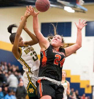 Holy Cross' Cayla Howard (23) is fouled by Watertown's Emily Deptula (24) while driving to the basket during their NVL semi-final game Monday at Kennedy High School in Waterbury. Jim Shannon Republican American