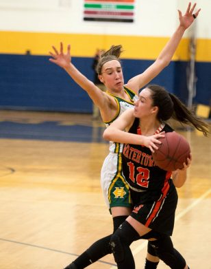 Watertown's Nicole DeFeo tries to get a pass off while being tightly defended by Holy Cross' Alyssa Hebb (10) during their NVL semi-final game Monday at Kennedy High School in Waterbury. Jim Shannon Republican American