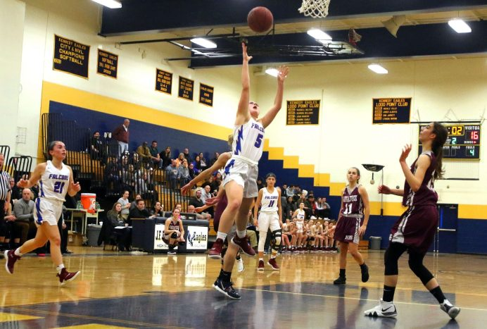 #5 Emma Cretella of St. Paul High puts up a shot over Naugatuck High during the NVL semi final at Kennedy High in Waterbury Monday. Steven Valenti Republican-American