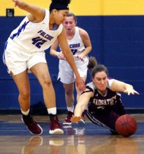 #24 Hailey Deitlebaum of Naugatuck High dives for the loose ball as #42 Jade Udoh of St. Paul High defends during the NVL semi final at Kennedy High in Waterbury Monday. Steven Valenti Republican-American