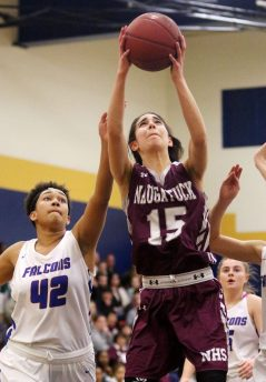 #15 Sara Macary of Naugatuck High puts up a shot over #42 Jade Udoh of St. Paul High during the NVL semi final at Kennedy High in Waterbury Monday. Steven Valenti Republican-American