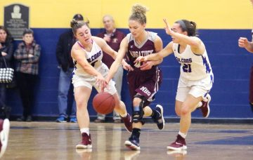 #0 Sarah Wisniewski of Naugatuck High tries to bring the ball up court as #5 Emma Cretella and #21 Catherine Ciampi of St. Paul High defend during the NVL semi final at Kennedy High in Waterbury Monday. Steven Valenti Republican-American